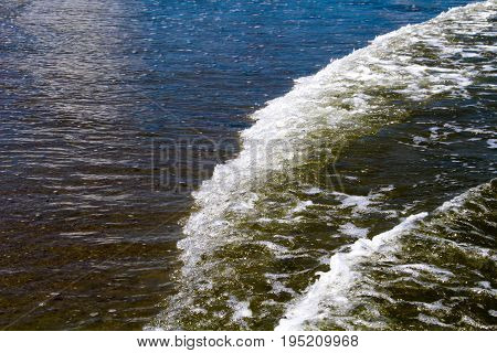 White water waves traveling toward the shoreside