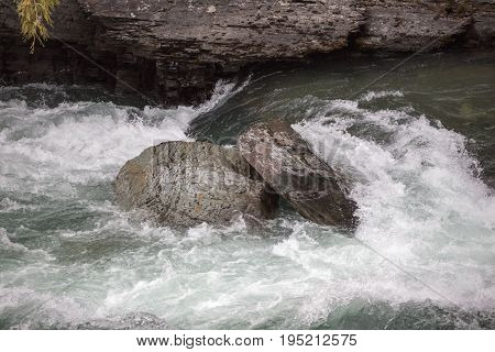 Swift current on a wild river in Glacier National Park Montana USA.