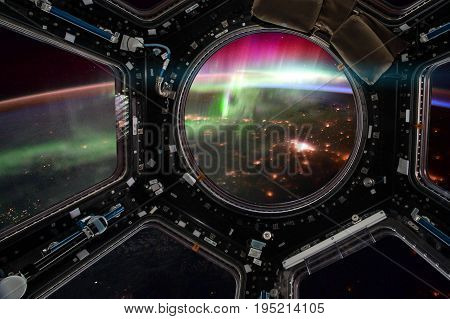 Earth and Galaxy in Spacecraft. Elements of this image furnished by NASA.