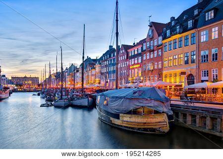 Nyhavn With Its Picturesque Harbor With Old Sailing Ships And Colorful Facades Of Old Houses In Cope