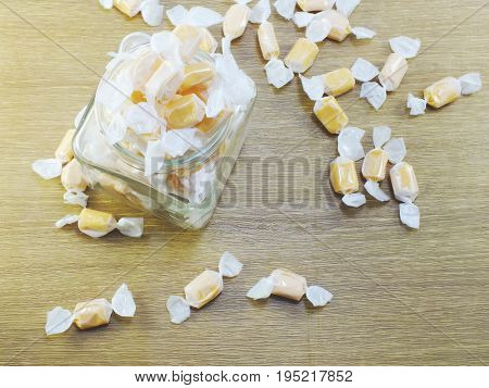 Sweet Milk Taffy Candy Background Top View On Wooden Background