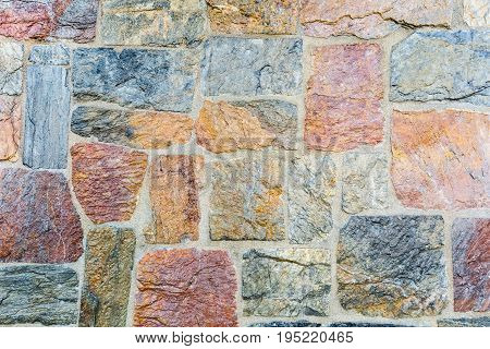 closeup of the stone wall texture background natural color