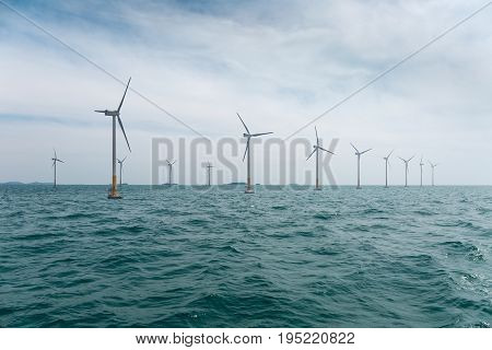 offshore wind farm with beautiful sea water clean energy background