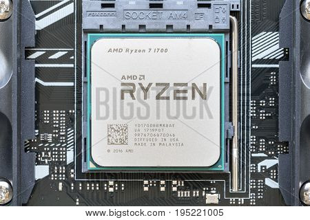 Melbourne, Australia - Jul 12, 2017: Close-up of AMD Ryzen 7 1700 CPU on motherboard. It is a high-performance microprocessor introduced by AMD in 2017.