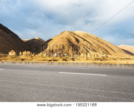 empty asphalt road with the autumn sun shines in the tibetan area highway background