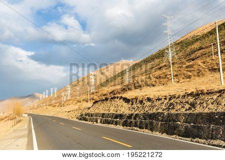 empty asphalt road on the plateau of autumn in tibetan area