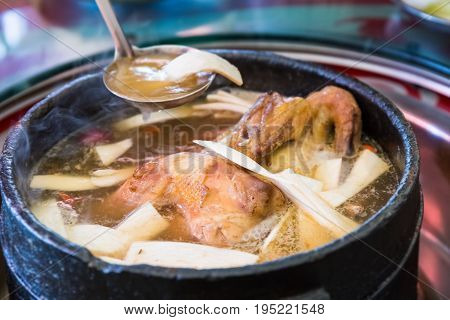 tibetan delicious food in stone pot to boil chicken with some wild fungus mushroom