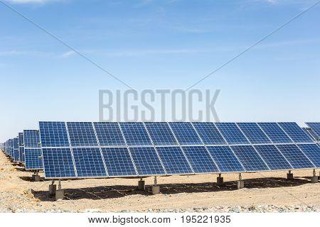 solar panels on the gobi desert new energy against a blue sky