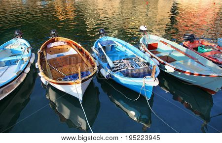 Colorful fishing boats floating in the Vernazza harbor in Cinque Terre Italy