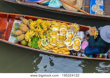 Long-tail boat with fruits on the floating market Ha long bay Vietnam
