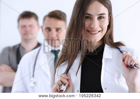 Group Of Medics Proudly Posing In Row And Looking In Camera