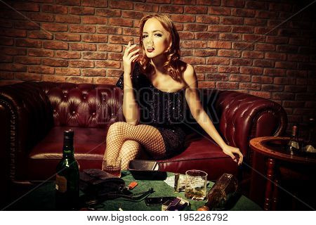 Glamorous young woman at night club or casino. Entertainment industry. Beauty, fashion concept.