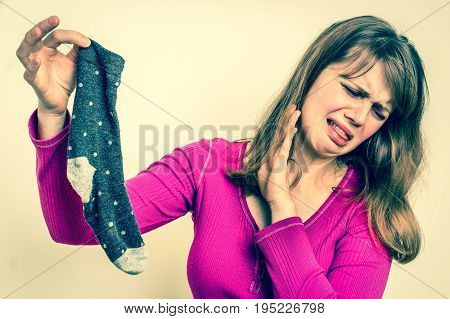 Woman With Stinky Sock Of Her Husband