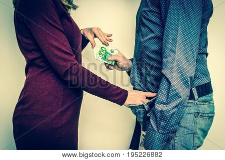Man paying woman for sex - prostitution and escort concept - retro style