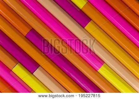 Collection of rose orange pencils in a diagonal line pattern as background picture