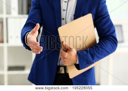 Businessman Offer Hand To Shake As Hello In Office