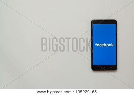 Los Angeles, USA, july 13, 2017: Facebook logo on smartphone screen on white background.