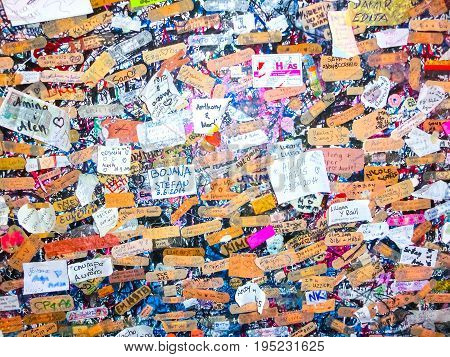 Verona, Italy - September 22, 2014: Lovers wall in verona Italy, Large wall of graffiti upon graffiti at Verona, Italy on September 22, 2014