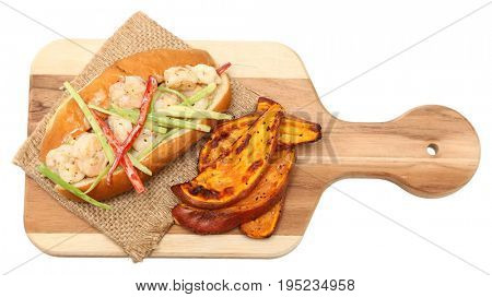 Shrimp Roll and Sweet Potato Wedges on cutting board over white.