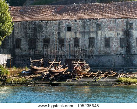Wooden Slipway And Rabelo Boats On The Bank Of The River Douro - Porto, Portugal
