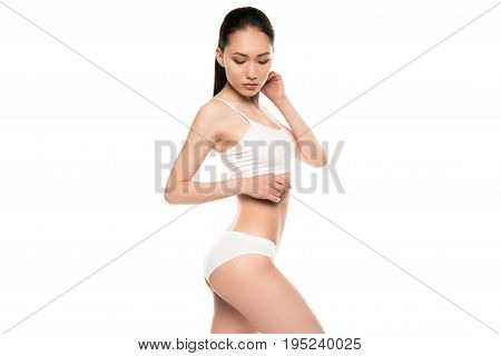 Slim Attractive Asian Woman Posing In White Underwear, Isolated On White