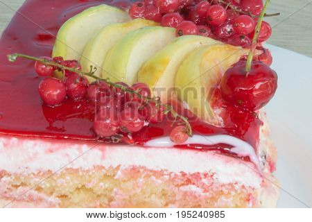 A piece cake on dish with currant in a relaxing time. Fruit Cake with fresh red currant on the plate closeup