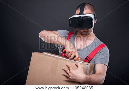 Mover Guy Wearing Vr Glasses Using Cutter On Box