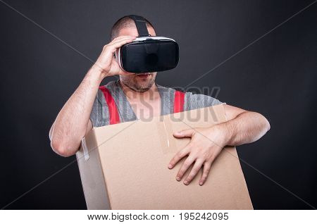 Mover Guy Holding Box Wearing Virtual Reality Glasses