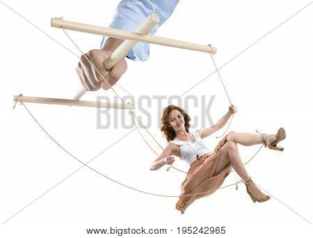 Cropped Shot Of Hand Of Puppeteer Manipulating Woman Isolated On White