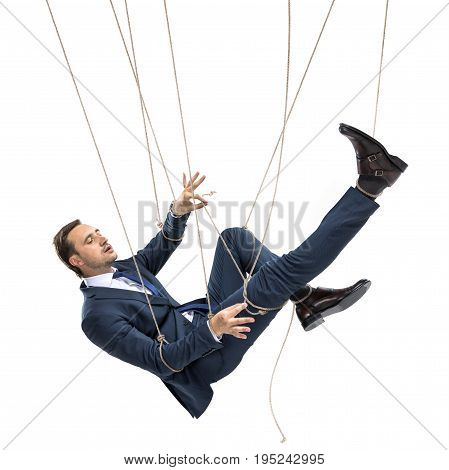 businessman trying to break free while hanging on manipulating ropes isolated on white poster