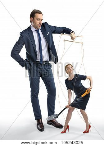 Businesswoman With Shovel In Hands Manipulated By Boss Isolated On White