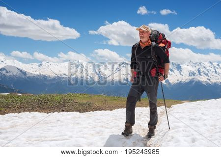Confident Man Traveler With Big Backpack On The Mountain Trail