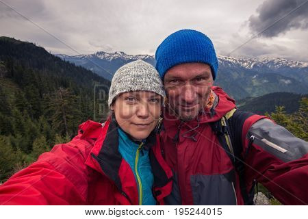 Funny Couple Of Travelers Taking Selfie On A Background Stormy Sky