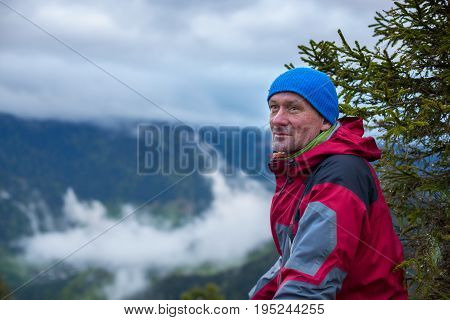 Portrait Of Happy Traveler In The Mountains