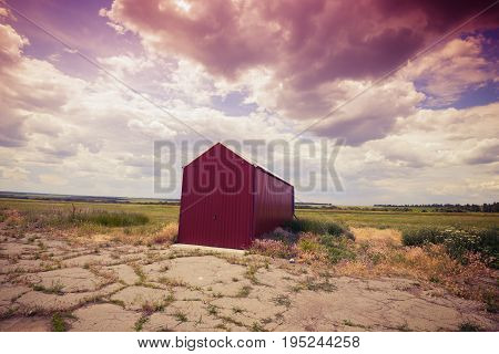 Lone Red Hangar On The Abandoned Airfield
