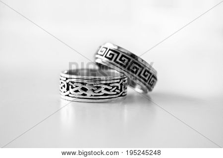 A pair of rings lying on top of eachother