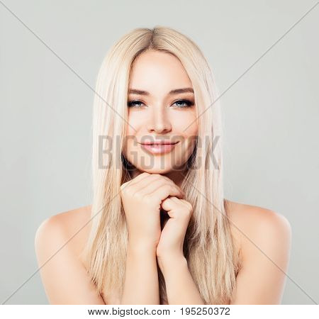 Smiling Spa Woman with Blonde Hair. Blondie Fashion Model with Shiny Skin and Natural Makeup