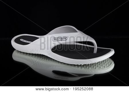 June, 2017: Rider Slipper. Rider Slipper, multinational company. Isolated on Black. Product shots.