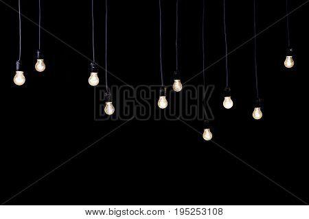 lot of light bulbs on a black background