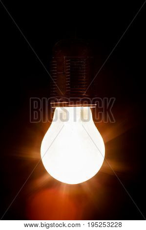 one light bulb on a black background