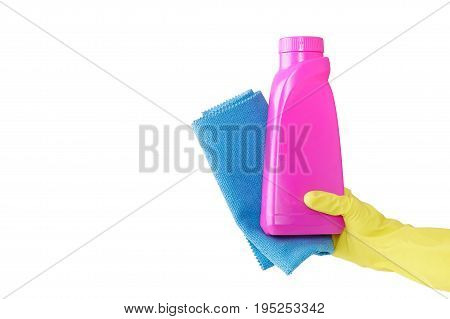 Hand in a rubber yellow glove holds pink bottle of liquid detergent  and a blue rag for duston a white background. cleaning
