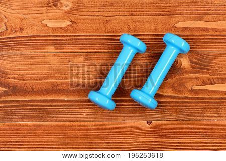 Sport Fitness Concept, Blue Dumbbells On Brown Vintage Wooden