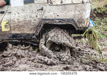 Offroad Car Stuck In Deep Mud With Flat Tyre.