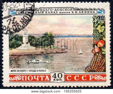 UKRAINE - CIRCA 2017: A postage stamp printed in USSR shows Volga lighthouse at the gate of the Canal from the series Volga-Don navigable canal named after V.I. Lenin circa 1953