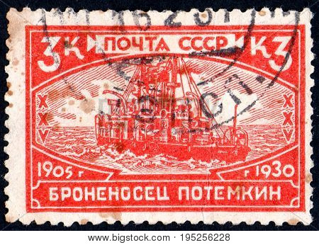 UKRAINE - CIRCA 2017: A postage stamp printed in USSR shows Battleship Potemkin from the series 25th Anniversary of Revolution of 1905 circa 1930