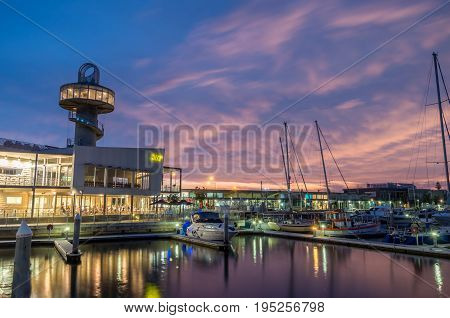 Queenscliff, Australia - March 12, 2017: Queenscliff Harbour on the Bellarine Peninsula contains a marina, restaurants and shops