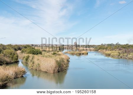 The Orange River (Gariep River) with the town of Groblershoop in the back. It is the longest and largest river in South Africa