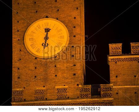 clock tower at night in the medieval Siena