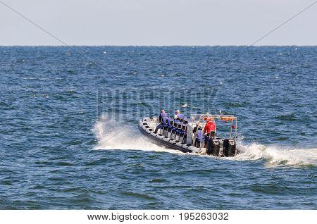 HOLIDAY ENTERTAINMENT - Speedboat cruising on the sea