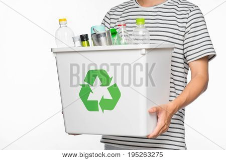 Eco concept. Male hands holding recycling bin full of recyclable items isolated on a white background.